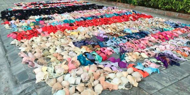 Hundreds of stolen women's underwear are placed on the ground after being found hidden in the ceiling...