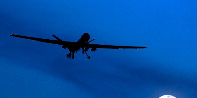 FILE - In this Jan. 31, 2010 file photo, an unmanned U.S. Predator drone flies over Kandahar Air Field,...