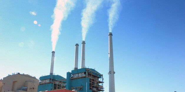 FILE - This July 1, 2013 file photo smoke rises from the Colstrip Steam Electric Station, a coal burning...