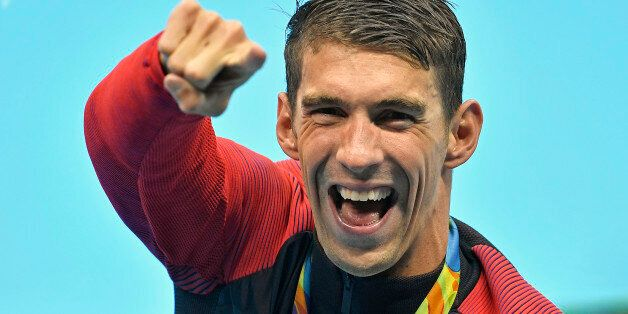 United States' Michael Phelps celebrates after winning the gold medal in the men's 4x100-meter final...