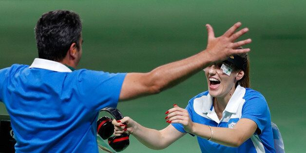 Anna Korakaki (R) of Greece celebrates with her coach, also her father after the women's 25m pistol final...