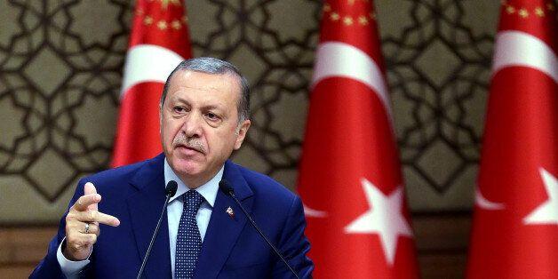 Turkey's President Recep Tayyip Erdogan speeches to the heads of chambers of commerce in Ankara, Turkey,...