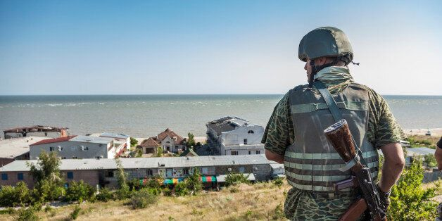 Soldier of the Donbass battalion goes to his surveillance post in the frontline of Shyrokyne, Ukraine....