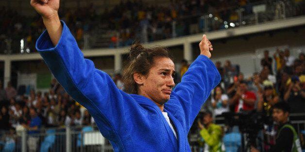 RIO DE JANEIRO, BRAZIL - AUGUST 07: Majlinda Kelmendi of Kosovo (blue) shows her emotions as she celebrates...