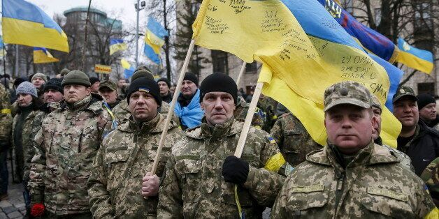 Members of self-defence battalions take part in a rally to commemorate demonstrators who were killed...