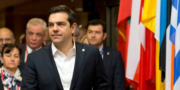 Greek Prime Minister Alexis Tsipras, center, leaves an EU summit in Brussels on Friday, March 18, 2016....