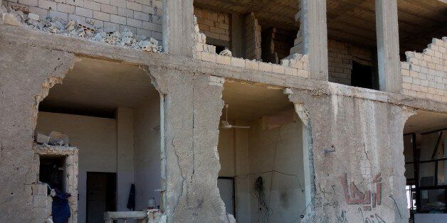 IDLIB, SYRIA - JULY 28: Debris of a collapsed building of a blood bank is seen after Russian forces'...