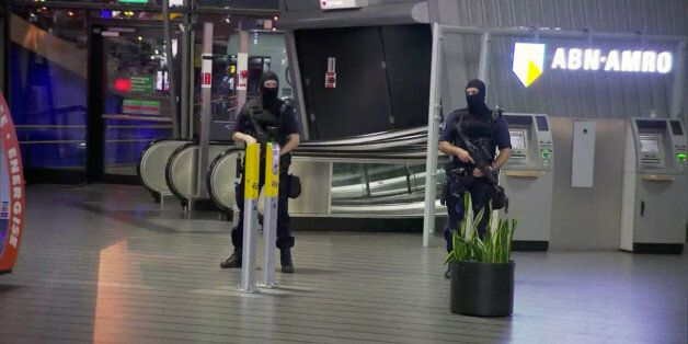 This image made from a video from RTL shows police at Schiphol Airport in Amsterdam, Tuesday, April 12,...