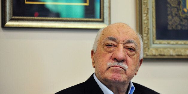 Islamic cleric Fethullah Gulen poses for a photo while speaking to members of the media at his compound,...