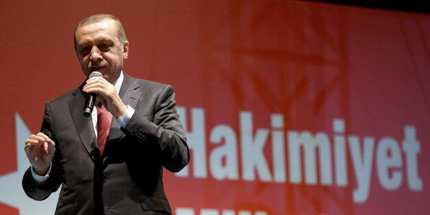 Turkey's President Recep Tayyip Erdogan addresses his supporters gathered in front of his residence in...
