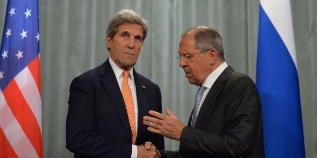 Russian Foreign Minister Sergei Lavrov (R) shakes hands with US Secretary of State John Kerry after their...