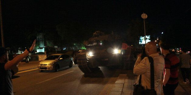 Tanks move into position as Turkish people attempt to stop them, in Ankara, Turkey, late Friday, July...