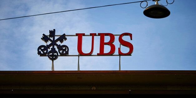 A photo taken on February 2, 2016 shows the logo of Swiss bank UBS on a building on Paradeplatz in Zurich.Swiss...