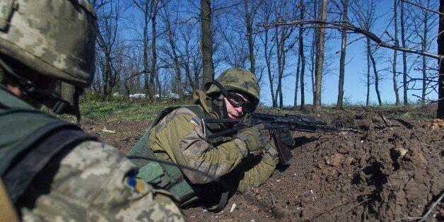 Ukrainian military servicemen control their position during a ceasefire outside Avdiivka, eastern Ukraine,...