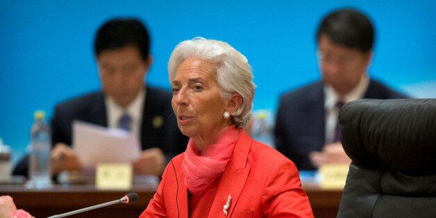 International Monetary Fund (IMF) director Christine Lagarde (C) speaks at the 1+6 Roundtable on promoting...