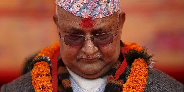 Nepal's Prime Minister Khadga Prasad Sharma Oli, also known as K.P. Oli, observes a minute of silence...