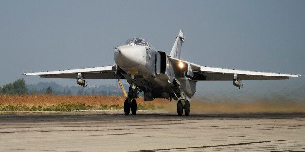 FILE - In this Oct. 22, 2015 file photo, a Russian Su-24 takes off on a combat mission at Hemeimeem airbase...