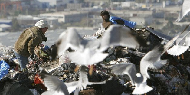Ragpickers collect pieces of garbage at Athens' landfill in Ano Liossia, north of the capital, on Friday,...