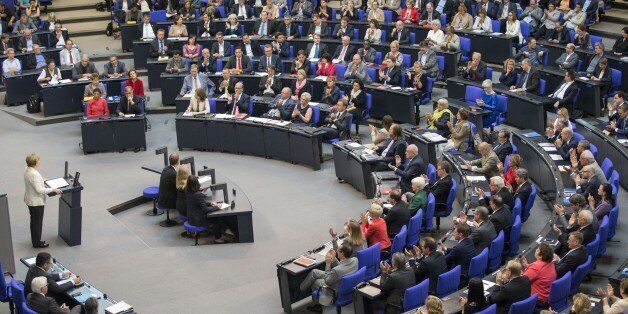 BERLIN, GERMANY - JUNE 28: German Chancellor Angela Merkel delivers a speech during a meeting on the...