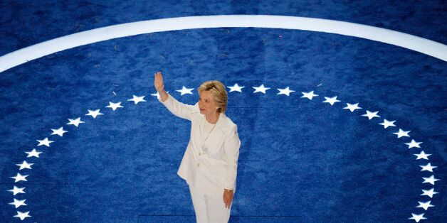 Democratic presidential nominee Hillary Clinton waives as she walks on stage to accept her nomination...