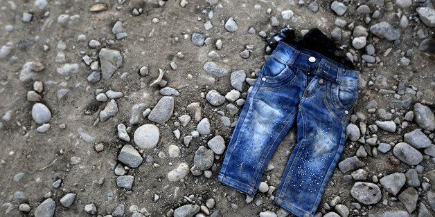 A pair of jeans from a refugee child is seen on a beach at the Greek island of Lesbos November 16, 2015....