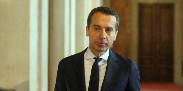 New Austrian Chancellor Christian Kern leaves a government meeting at the parliament in Vienna, Austria,...