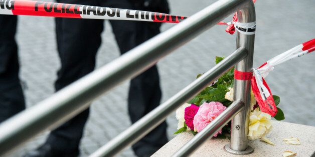 MUNICH, GERMANY - JULY 23: Flowers layed by people outside the OEZ shopping center the day after a shooting...