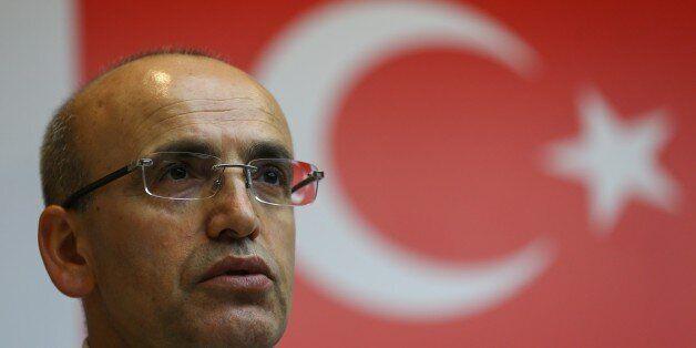 ANKARA, TURKEY - APRIL 26: Deputy Prime Ministers of Turkey Mehmet Simsek listens during a joint press...