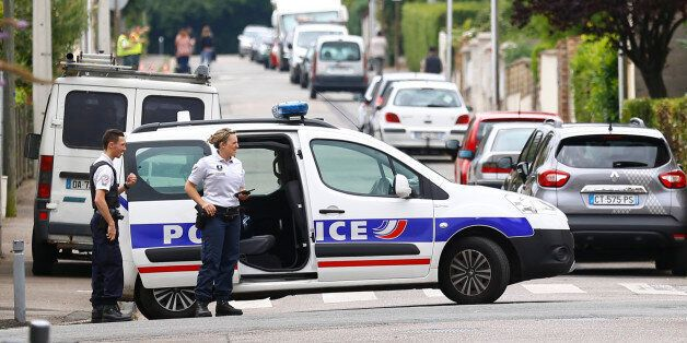 French police officers prevent the access to the scene of an attack in Saint Etienne du Rouvray, Normandy,...