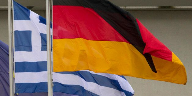 European, Greek and German flags fly outside the Chancellery in Berlin, August 24, 2012. The parliamentary...