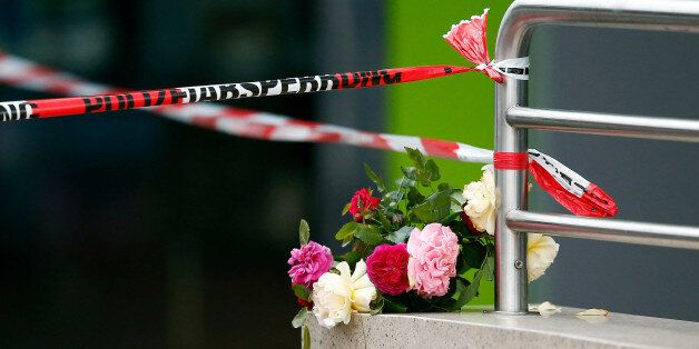 Flowers are placed near the Olympia shopping mall, where yesterday's shooting rampage started, in Munich,...