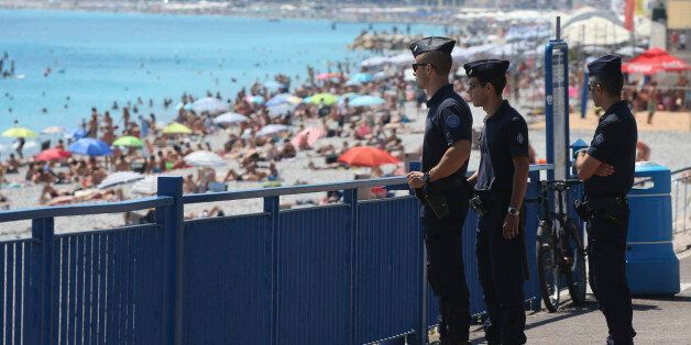 French police officers patrol on the famed Promenade des Anglais in Nice, southern France, three days...