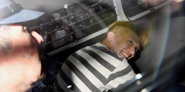 Satoshi Uematsu, suspected of a deadly attack at a facility for the disabled, is seen inside a police...