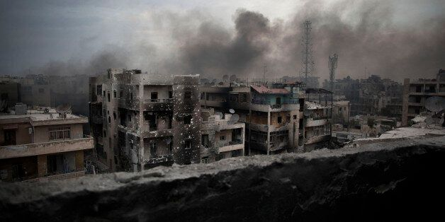 FILE - In this Tuesday, Oct. 2, 2012 file photo, smoke rises over Saif Al Dawla district, in Aleppo,...