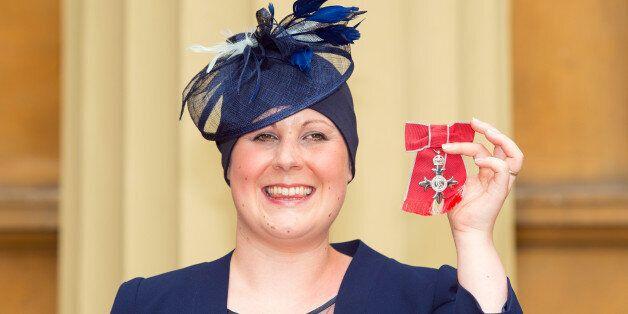 LONDON, ENGLAND - JUNE 12: Kate Granger holds her MBE which was awarded to her by the Prince of Wales...