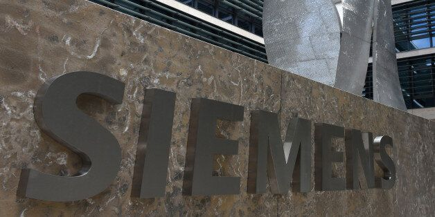 German engineering giant Siemens' logo is pictured in front of the main entrance of the new headquarters...