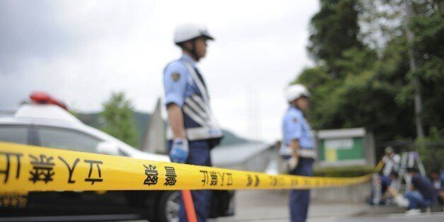 SAMIGAHARA, JAPAN - JULY 26 : Police are seen on the site where Satoshi Uematsu, 26, killed 19 and wounding...