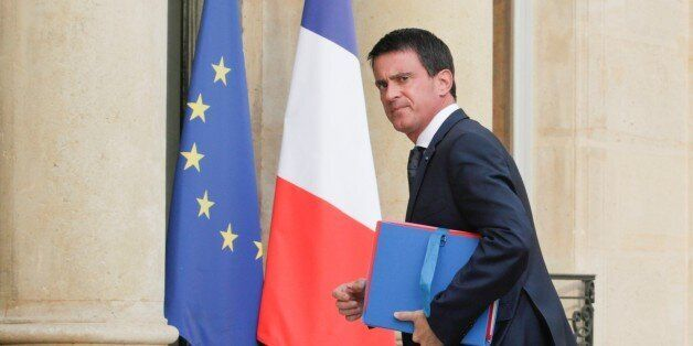PARIS, FRANCE - JULY 27 : French Prime Minister Manuel Valls arrives at the Elysee Palace for the meeting...