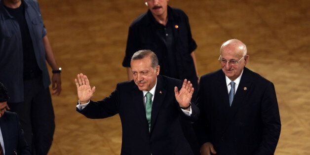 Turkey's President Recep Tayyip Erdogan salutes after his address at the parliament in Ankara, Turkey,...