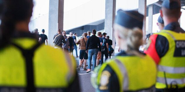 STOCKHOLM, SWEDEN - JULY 25: Players buses protected by police as frustrated fans of Djurgardens IF demanded...