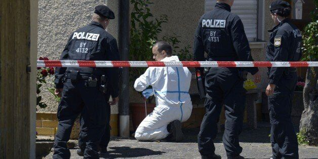 Police are seen investigating a crime scene in Tiefenthal-Leutershausen near Ansbach, southern Germany,...