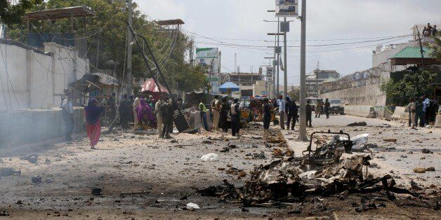 MOGADISHU, SOMALIA - JULY 31 : Wreckage of a car is seen at the scene of a suicide attack outside Criminal...