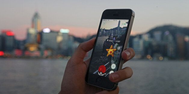 A fan maneuvers his smartphone as he