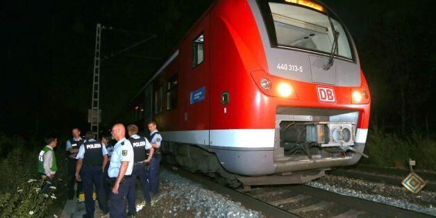 Police officers stand by a regional train in Wuerzburg southern Germany on July 18, 2016 after a man...