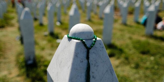 A rosary is placed on a tombstone at the Memorial Center Potocari, near Srebrenica, Bosnia and Herzegovina...