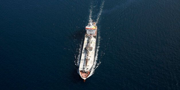 A tanker operated by SCF Group sails from port in the Aegean sea off the coast of Athens, Greece, on...