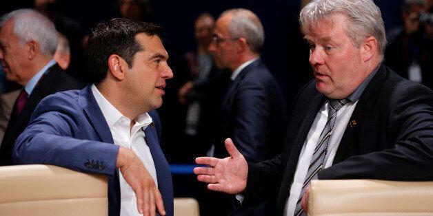 Greece's Prime Minister Alexis Tsipras and Iceland's Prime Minister Sigurdur Ingi Johannsson arrive for...