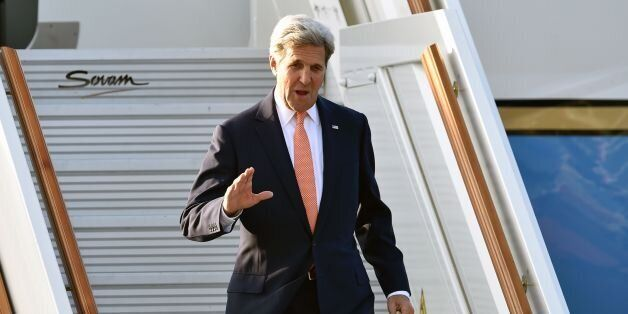 US Secretary of State John Kerry waves as he arrives at Vnukovo-II governmental airport in Moscow on...