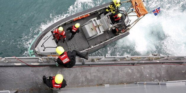 Icelandic coast guards prepare to patrol on a rubber dinghy from the vessel Tyr as they sail to off the...