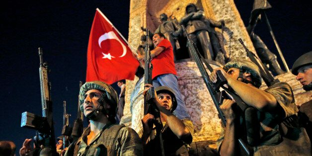 Turkish soldiers secure the area as supporters of Turkey's President Recep Tayyip Erdogan protest in...
